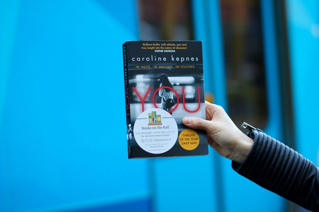 train, book on the rail